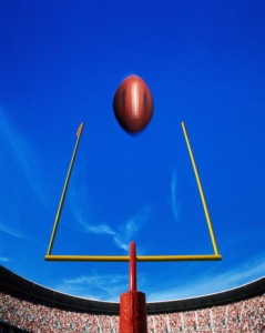 American football, ball flying over goal (Digital Composite)